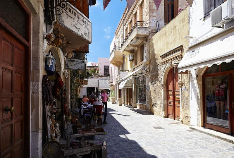 RETHYMNO, GREECE - MAY 27, 2017: Buildings and cafe in old town of Rethymno. City is famous for its splendid beaches and venetian architecture, as well as for stock photo