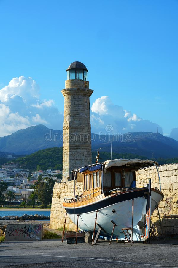 Rethymno, Greece, September 30 2018 View of the port of Rethymno and its lighthouse called Latarnia Morska. At sunset, monument, tower, greek, ancient, blue royalty free stock image