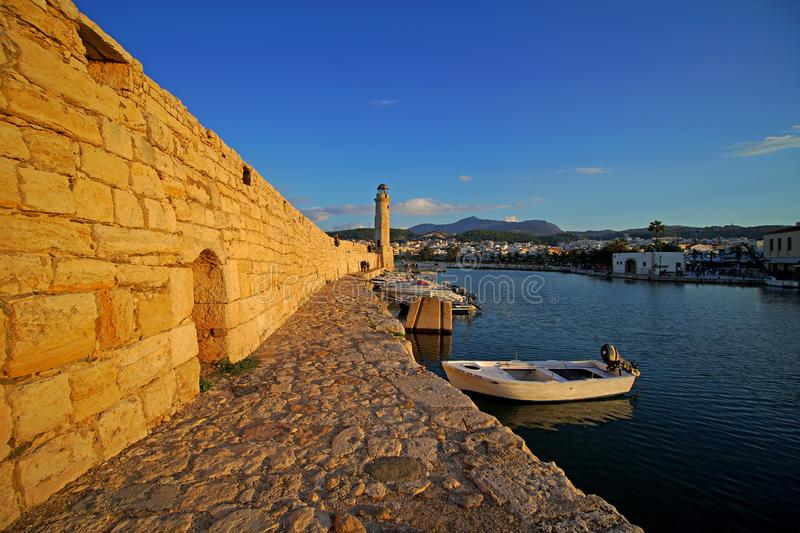 Rethymno, Greece, September 30 2018 View of the port of Rethymno and its lighthouse called Latarnia Morska. At sunset, monument, tower, greek, ancient, blue royalty free stock photography