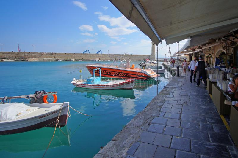Rethymno, Greece, September 30 2018 View of the port of Rethymno with its shops and its tourists. Rethymno, Greece, September 30 2018 View of the port of stock photos