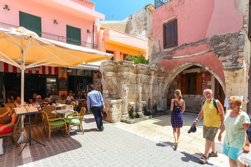 Rethymno, Island Crete, Greece, - July 1, 2016: People are eating in cafe located near the Rimondi Fountain in Rethymnon part of royalty free stock photo