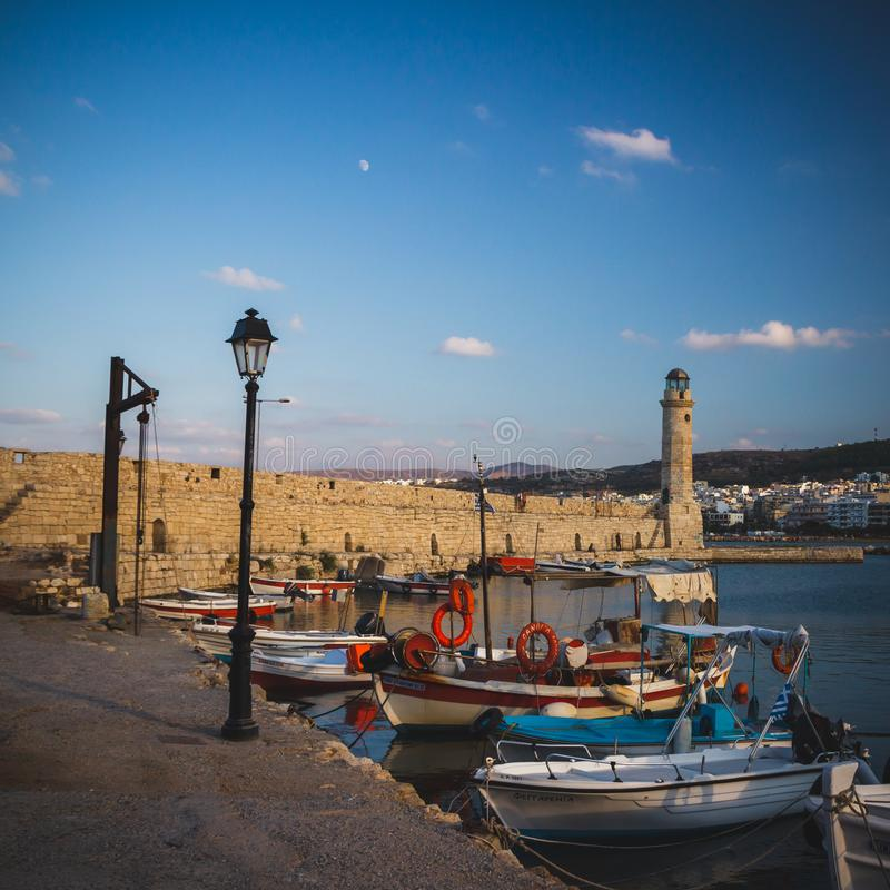 Rethymno town in Crete island, Greek island. Small sea harbour with lighthouse stock photography