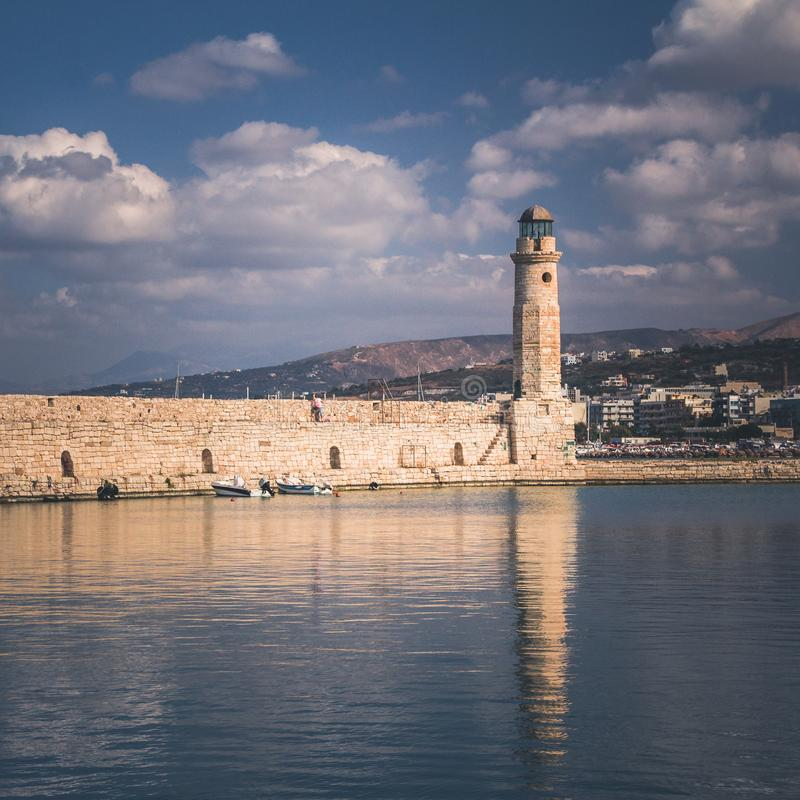 Rethymno town in Crete island, Greek island. Small sea harbour with lighthouse royalty free stock photography