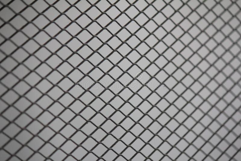 Reticolato della maglia del recinto Fondo del recinto di filo metallico Recinto senza cuciture del collegamento a catena del meta fotografia stock