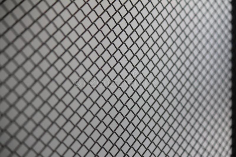 Reticolato della maglia del recinto Fondo del recinto di filo metallico Recinto senza cuciture del collegamento a catena del meta fotografia stock libera da diritti