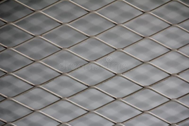 Reticolato della maglia del recinto Fondo del recinto di filo metallico Recinto senza cuciture del collegamento a catena del meta fotografie stock libere da diritti