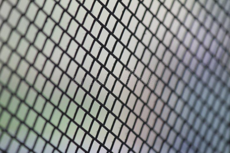 Reticolato della maglia del recinto Fondo del recinto di filo metallico Recinto senza cuciture del collegamento a catena del meta immagini stock