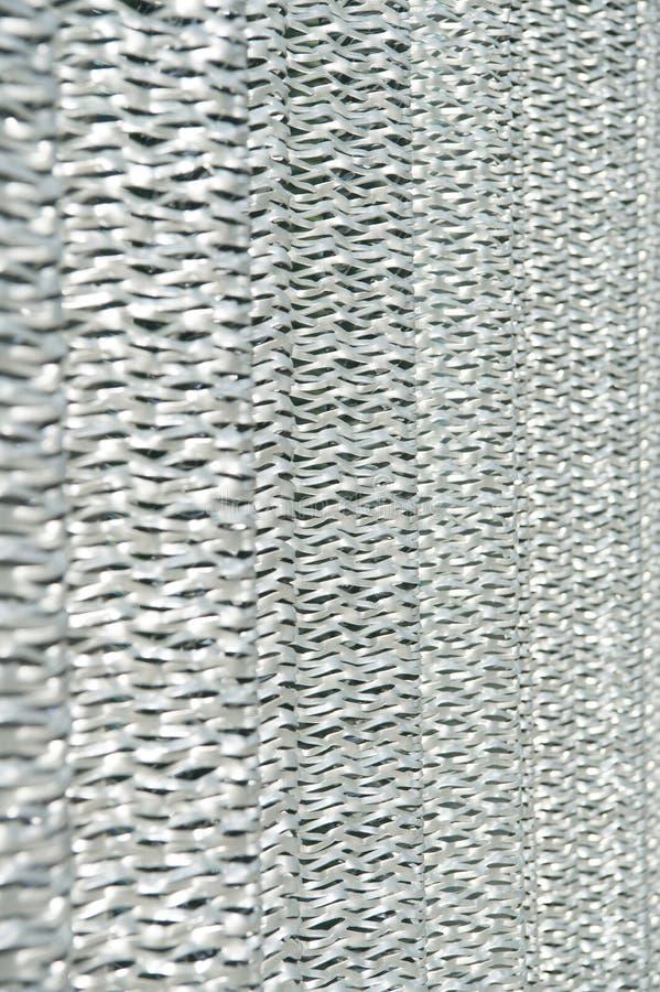 Reticolato metallico Materiale protettivo Riciclaggio del metallo Schermo metallico Concetto industriale Produzione del ferro tag immagini stock