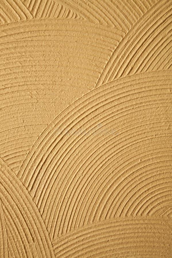 Reticoli del cerchio in una parete dello stucco fotografia stock