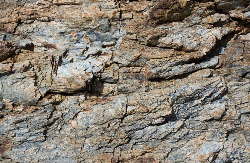 Reticolo di pietra della roccia, ambiti di provenienza strutturati fotografia stock