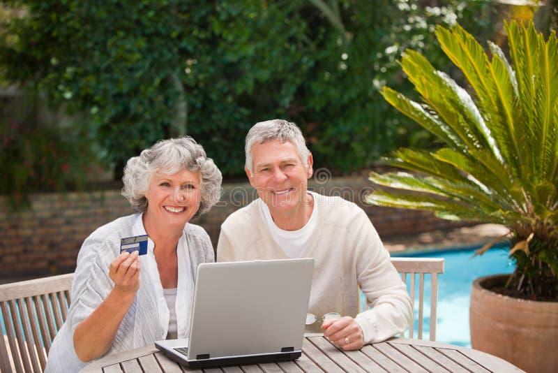 Download Retired Couple Buying Something On Internet Stock Photo - Image: 18106234