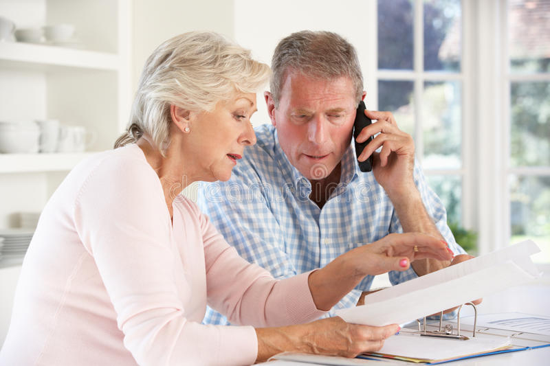 Download Retired Couple With Household Bills Stock Photo - Image: 25391726