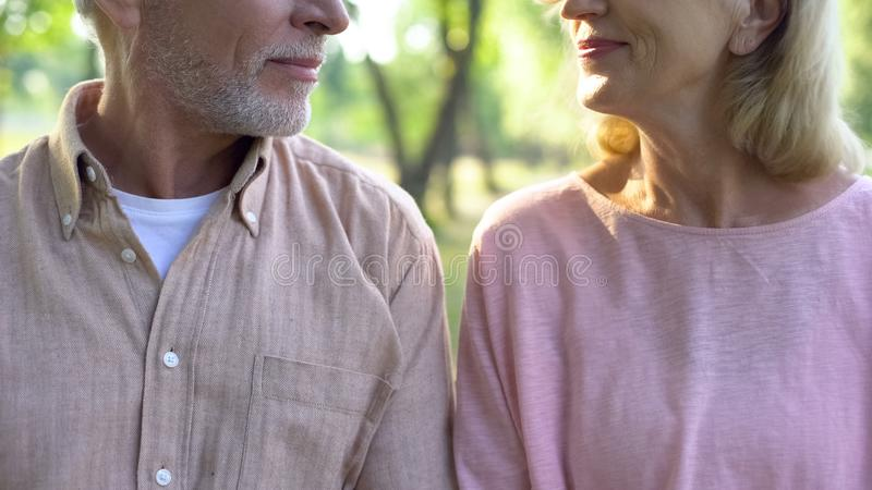 Retired couple looking each other, romantic date outdoor, relation closeness. Stock photo stock photography