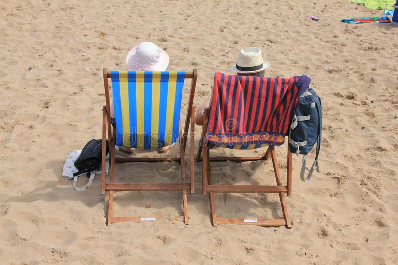 Retired couple, man and wife on the beach. royalty free stock photos