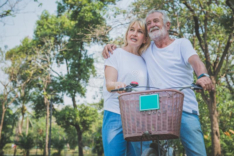 Retired couple mountain biking outside stock images