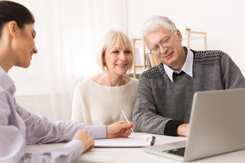 Retired Couple Planning Investments With Financial Consultant stock photo