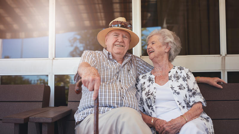 Retired couple taking a break and relaxing outdoors stock images