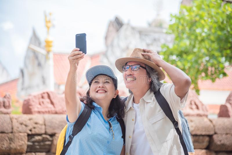 Retired couple taking their photo by smart phone stock photos