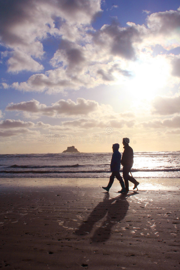 Free Retired Couple Walking On The Beach Royalty Free Stock Photo - 2194655