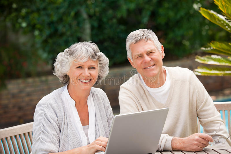 Retired Couple Working On Their Laptop Royalty Free Stock Photos