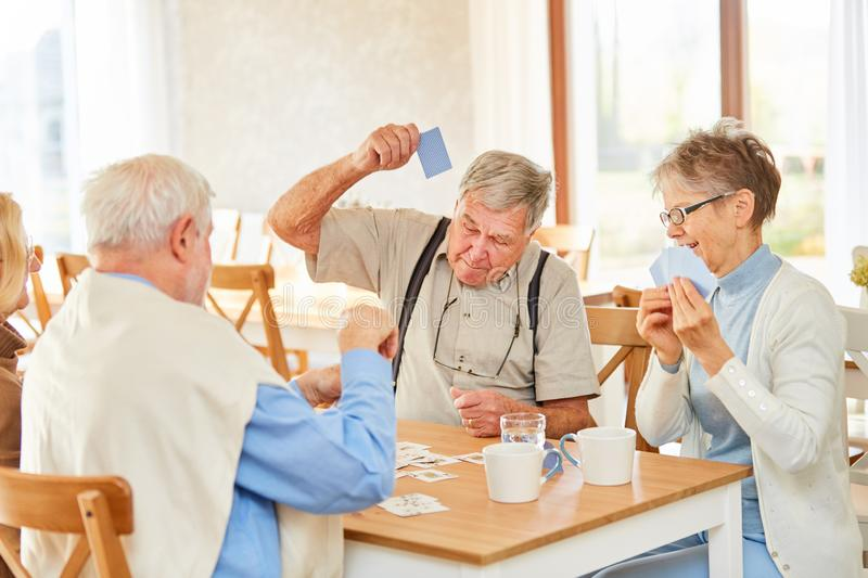 Retired group retired at card game stock photo