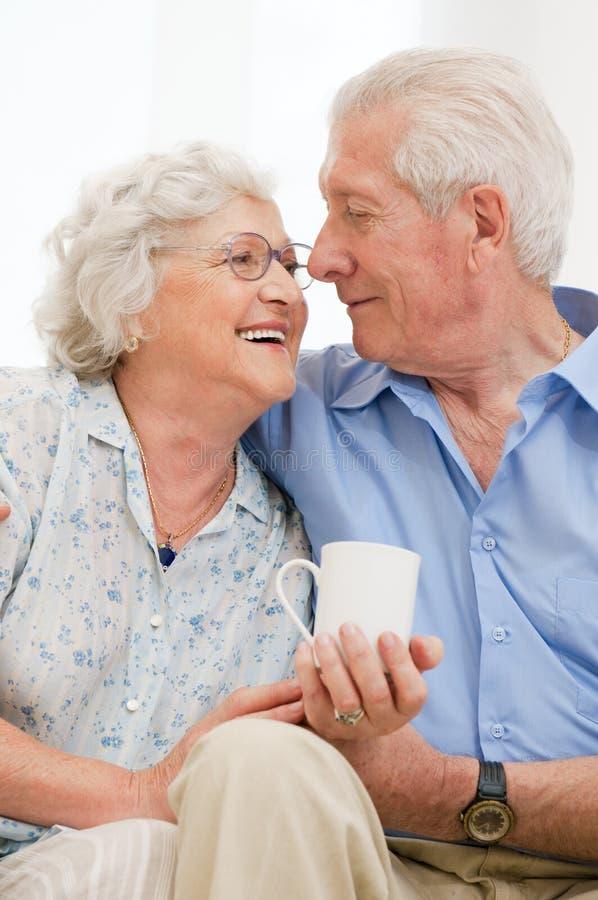 Retired loving aged couple stock image