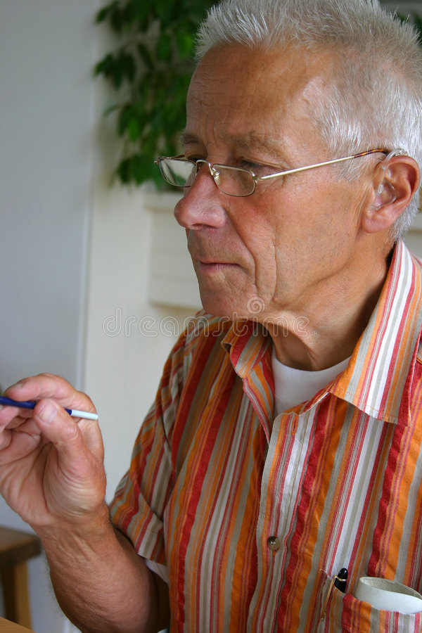 Download Retired man painting stock photo. Image of masculine, seniors - 165696
