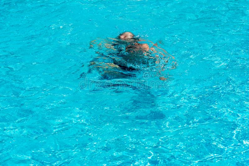 Retired men are drowning. Because they are weak while he swims in the pool, to sport and recreation concept royalty free stock photos