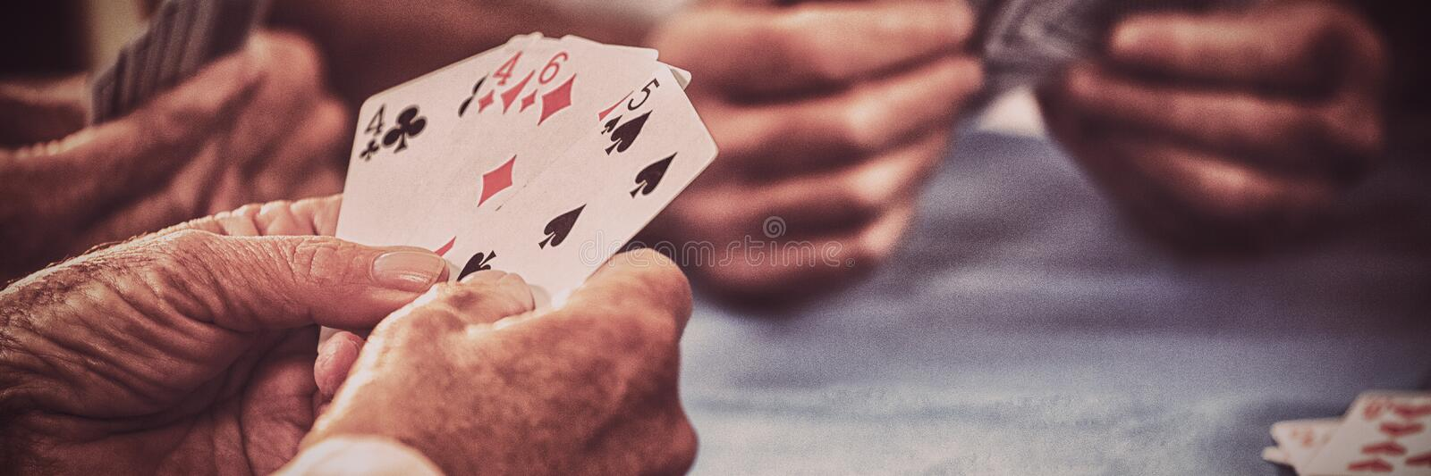 Retired people playing card royalty free stock photos