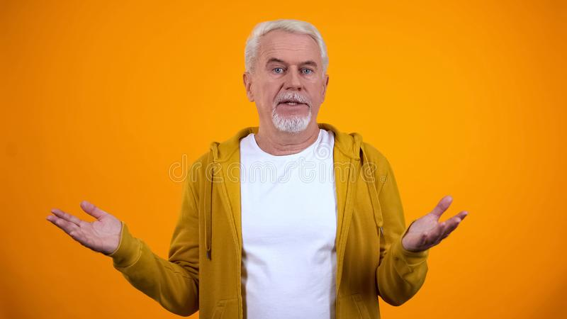 Retired person showing no idea gesture with hands, lack of information, answer. Stock photo stock images