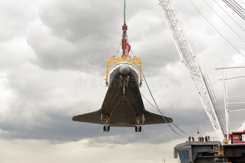 A retired space shuttle on the crane royalty free stock photos
