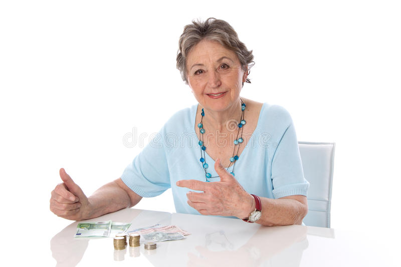 Retired woman counts her finances - elder woman isolated on whit royalty free stock photography