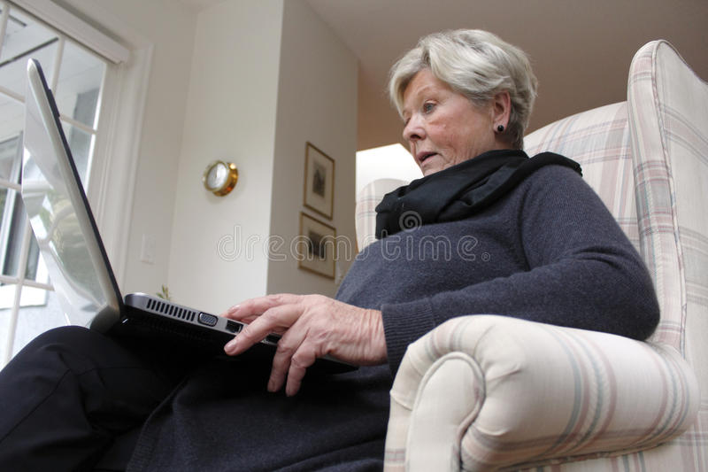 Retired Woman With Laptop Royalty Free Stock Photo