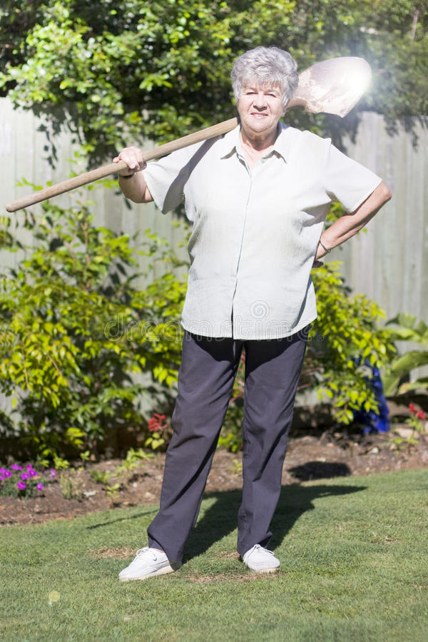 Download Retired Woman With Shovel stock image. Image of gray - 17504629