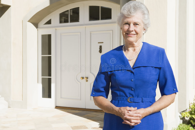 Download Retired Woman Standing Outside House Stock Image - Image: 5112999