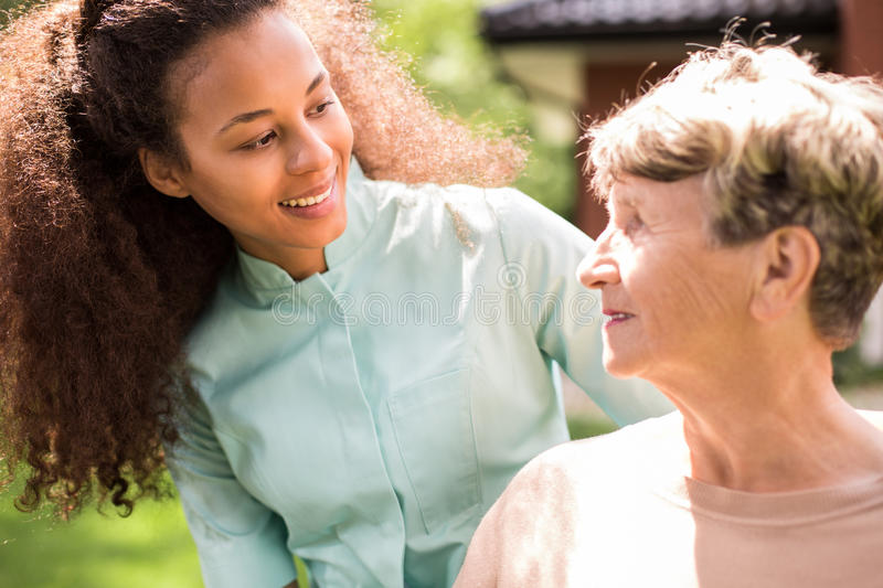 Retiree and African American nurse stock photo