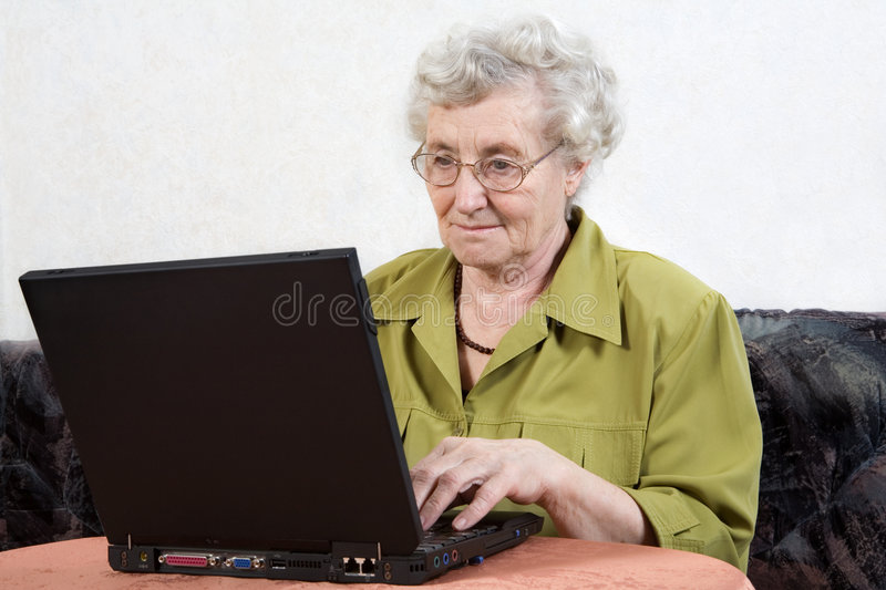 Retiree with laptop royalty free stock photo