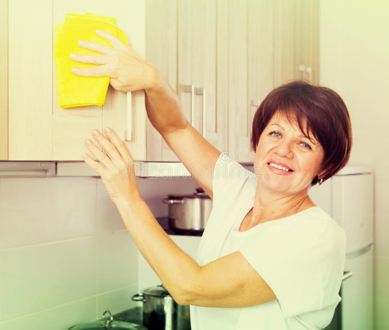 Download Retiree Woman Cleaning Home Stock Photo - Image: 83702638