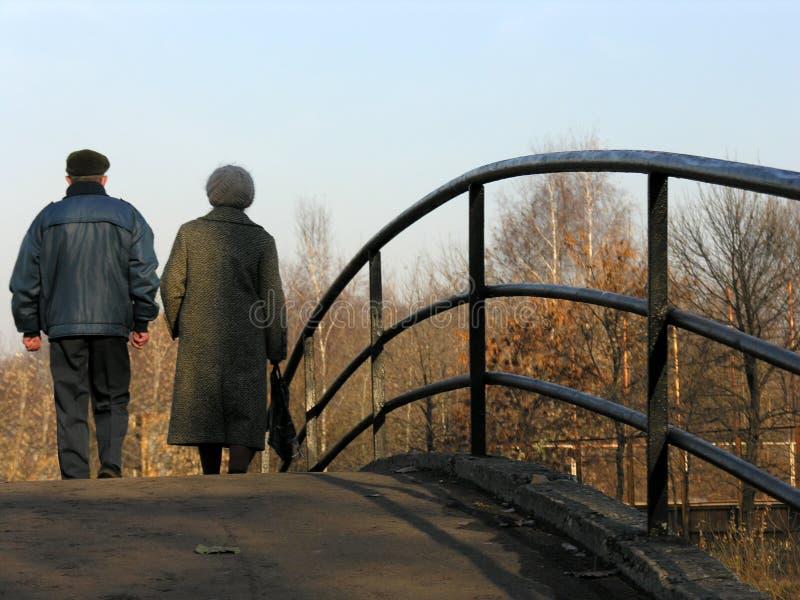 Retirees on bridge royalty free stock images