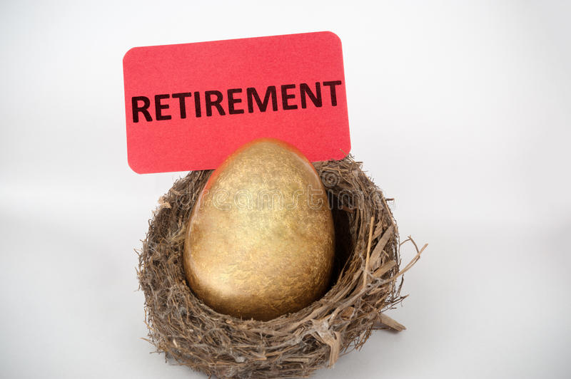Retirement concept. With golden egg in the bird nest royalty free stock images