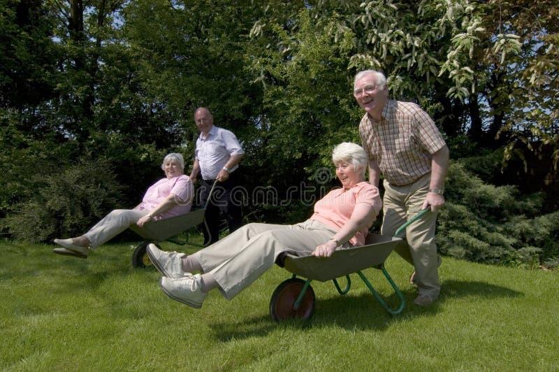 Retirement fun. Retired people having fun in the garden