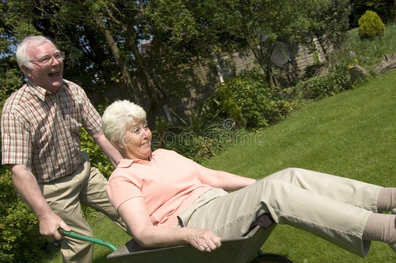 Retirement fun. Retired couple having fun in the garden