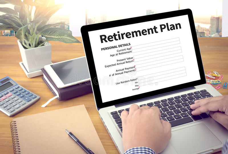 Retirement Plan Loan Liability Tax Form to Retirement Plan. Businessman working at office desk and using computer and objects, Gamification Business Concept royalty free stock images