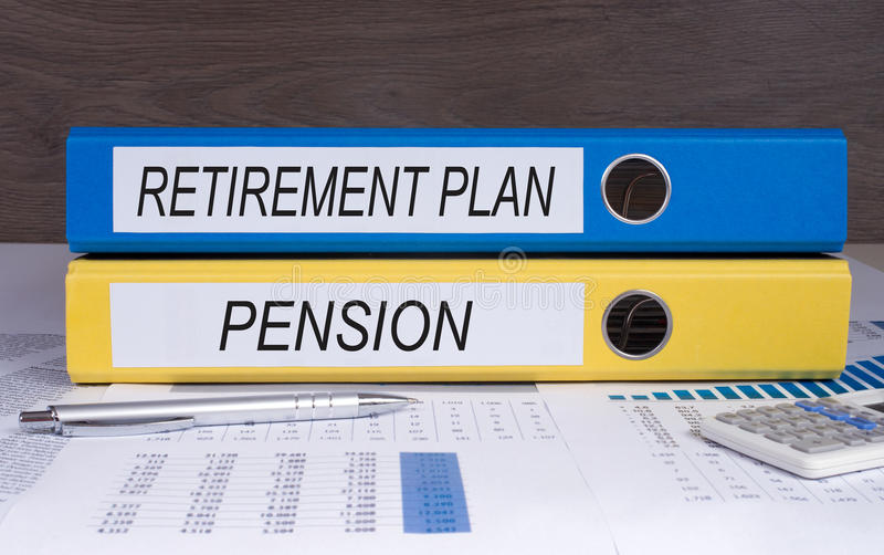 Retirement plan and pension folders. Office folders marked with retirement plan and pension on desktop with spreadsheets, calculator and pen stock photo