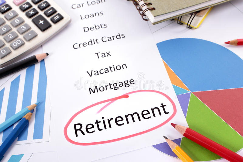 Retirement planning checklist. The word Retirement circled in red with a list of saving and debt obligations surrounded by graphs, charts, books and pencils stock image