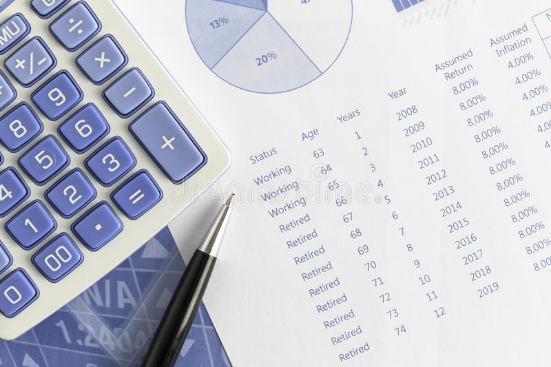 Retirement projections according to return and annual inflation with pen and calculator royalty free stock image