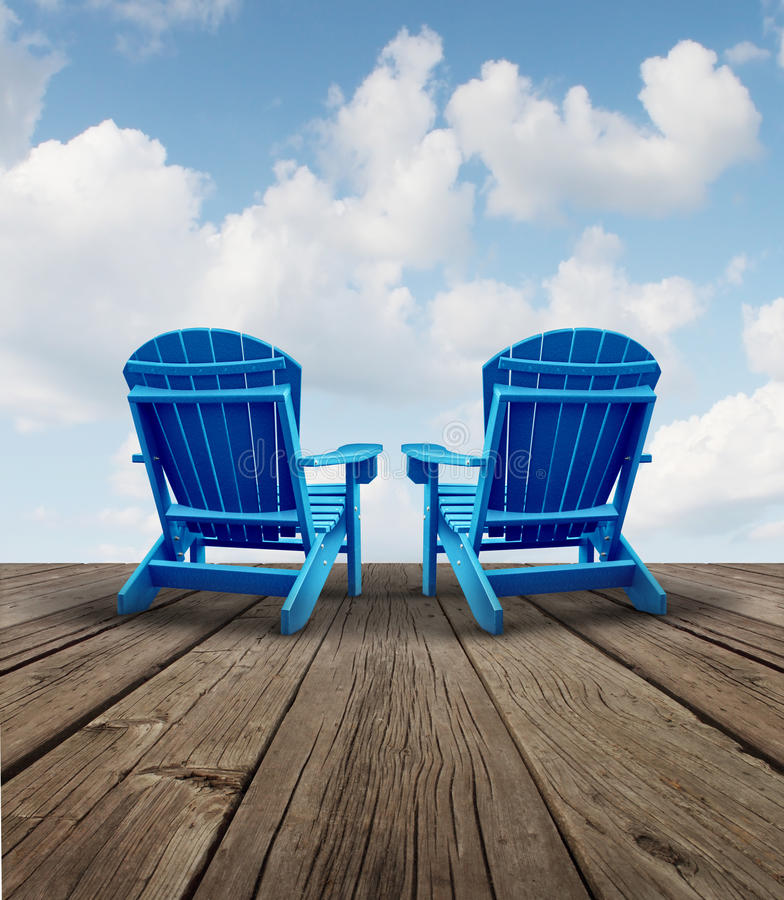 Retirement Relaxation. And financial planning symbol with two empty blue adirondack chairs on a wood patio deck with a sky view as a business freedom concept of