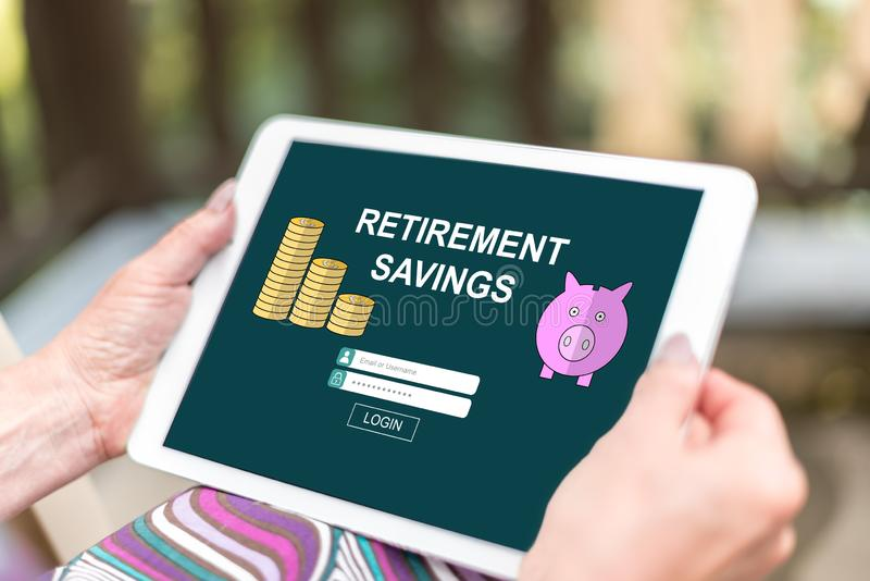 Retirement savings concept on a tablet. Female hands holding a tablet with retirement savings concept stock image