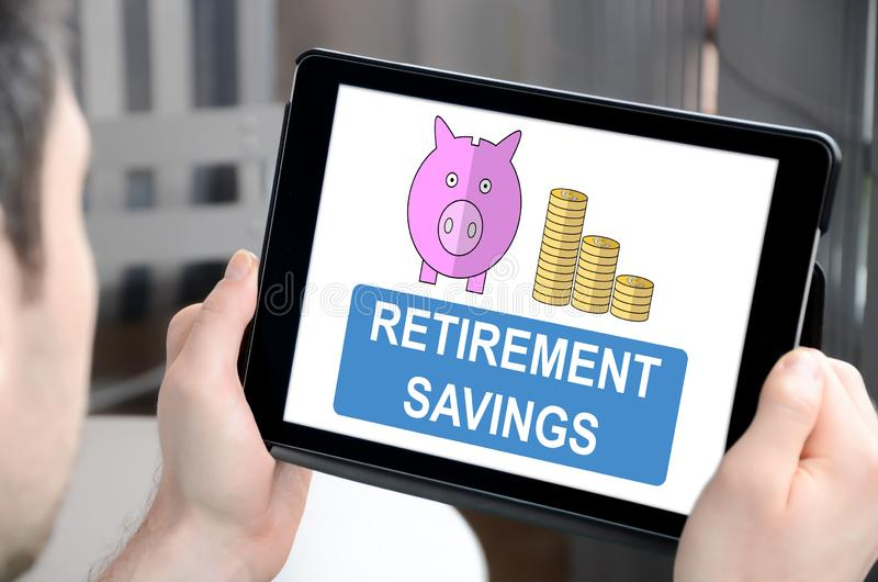 Retirement savings concept on a tablet. Man holding a tablet showing retirement savings concept royalty free stock photo