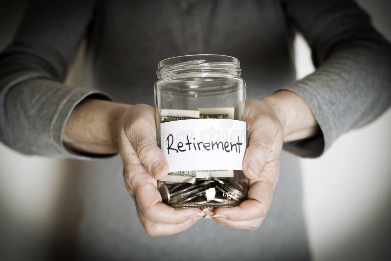 Retirement. Senior woman holding retirement jar royalty free stock photography